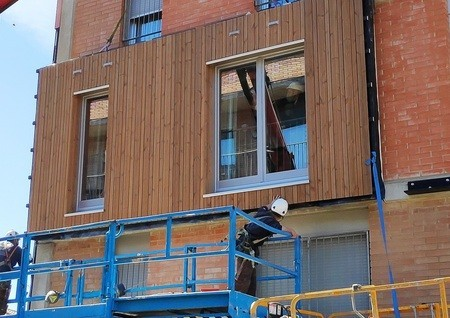 Prefabricated wooden-based façade systems to save energy