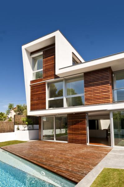 Casa unifamiliar aislada en roses construction21 - Fachadas viviendas unifamiliares ...