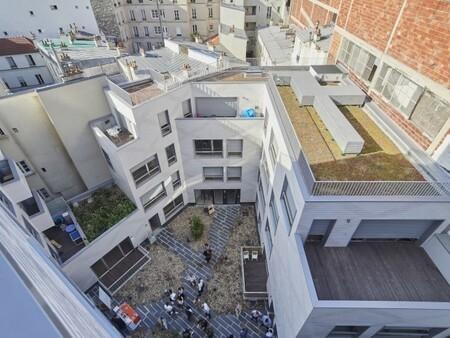Un garage transformé en logements sociaux au cœur de Paris